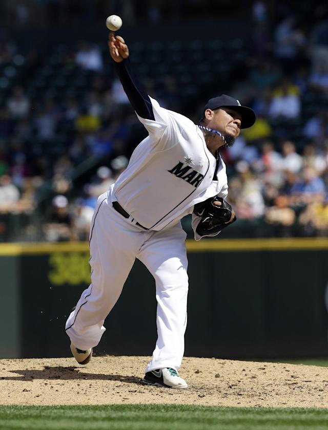 Seattle Mariners starting pitcher Felix Hernandez throws in the fourth inning of a baseball game against the Milwaukee Brewers, Sunday, Aug. 11, 2013, in Seattle. (AP Photo/Ted S. Warren)