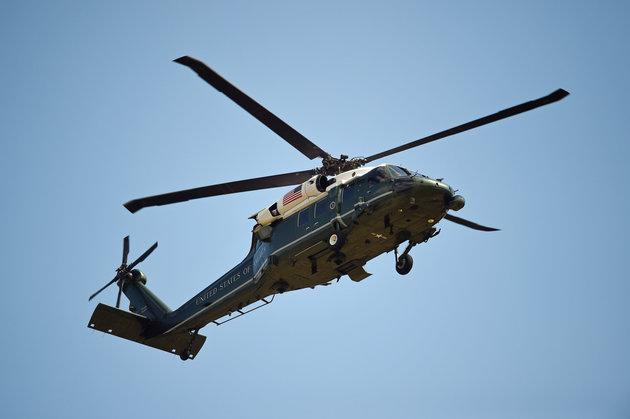 A helicopter of the US Marine Corps comes into land at the residence of the US Ambassador in London's Regent's Park.