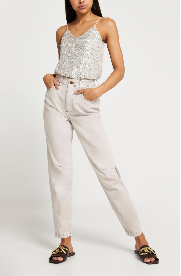 """<p><strong>River Island</strong></p><p>nordstrom.com</p><p><strong>$50.00</strong></p><p><a href=""""https://go.redirectingat.com?id=74968X1596630&url=https%3A%2F%2Fwww.nordstrom.com%2Fs%2Friver-island-sequin-camisole%2F5978568&sref=https%3A%2F%2Fwww.cosmopolitan.com%2Fstyle-beauty%2Ffashion%2Fg37193145%2Fwinter-fashion-trends-2021-2022%2F"""" rel=""""nofollow noopener"""" target=""""_blank"""" data-ylk=""""slk:Shop Now"""" class=""""link rapid-noclick-resp"""">Shop Now</a></p><p>Just because sequins are involved don't mean you have to look over-the-top. This tank with jeans strikes the perfect balance between fancy and casual. </p>"""