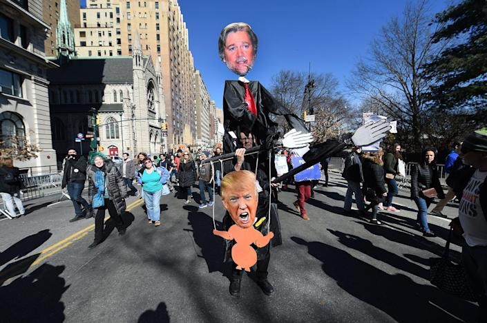 """<p>Protesters march down Central Park West in New York City during a """"Not My President's Day"""" rally on Feb. 20, 2017, as part of a protest against President Trump. (Timothy A. Clary/AFP/Getty Images) </p>"""