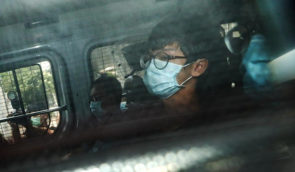 Tony Chung is escorted by police to West Kowloon Court to be charged under the national security law on Thursday. Photo: Sam Tsang
