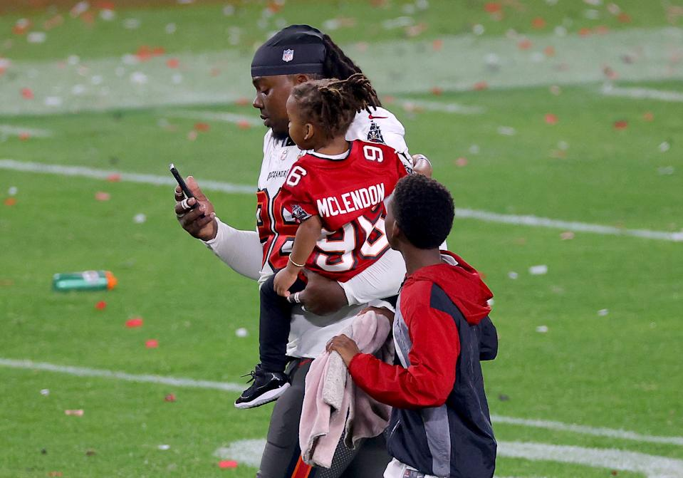 Steve McLendon #96 of the Tampa Bay Buccaneers leaves the field with his children after defeating the Kansas City Chiefs 31-9 in Super Bowl LV at Raymond James Stadium on February 07, 2021 in Tampa, Florida. (Photo by Kevin C. Cox/Getty Images)