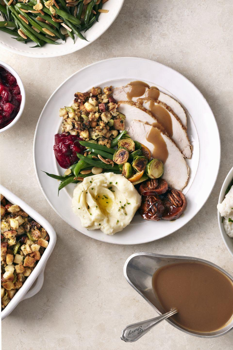 """<p>A juicy, flavorful turkey is almost guaranteed if you soak or """"brine"""" the bird in a saltwater bath before roasting, like the turkey featured on this festive menu.</p><p><strong>Starters:</strong></p><p><a href=""""https://www.countryliving.com/food-drinks/recipes/a1781/peppered-goat-cheese-citrus-carrot-marmalade-3900/"""" rel=""""nofollow noopener"""" target=""""_blank"""" data-ylk=""""slk:Peppered Goat Cheese with Citrus-Carrot Marmalade"""" class=""""link rapid-noclick-resp"""">Peppered Goat Cheese with Citrus-Carrot Marmalade</a></p><p><a href=""""https://www.countryliving.com/food-drinks/recipes/a1392/holiday-oyster-stew-3504/"""" rel=""""nofollow noopener"""" target=""""_blank"""" data-ylk=""""slk:Holiday Oyster Stew"""" class=""""link rapid-noclick-resp"""">Holiday Oyster Stew</a></p><p><a href=""""https://www.countryliving.com/food-drinks/recipes/a1025/kenyon-johnnycakes-3131/"""" rel=""""nofollow noopener"""" target=""""_blank"""" data-ylk=""""slk:Kenyon Johnnycakes"""" class=""""link rapid-noclick-resp"""">Kenyon Johnnycakes</a></p><p><strong>Main Course</strong>:</p><p><a href=""""https://www.countryliving.com/food-drinks/recipes/a1137/roasted-apple-turkey-apple-brandy-gravy-3248/"""" rel=""""nofollow noopener"""" target=""""_blank"""" data-ylk=""""slk:Roasted Apple Turkey with Apple Brandy Gravy"""" class=""""link rapid-noclick-resp"""">Roasted Apple Turkey with Apple Brandy Gravy</a></p><p><strong>Side Dishes</strong>:</p><p><a href=""""https://www.countryliving.com/food-drinks/recipes/a1789/cranberry-pear-wild-rice-stuffing-3916/"""" rel=""""nofollow noopener"""" target=""""_blank"""" data-ylk=""""slk:Cranberry-Pear Wild-Rice Stuffing"""" class=""""link rapid-noclick-resp"""">Cranberry-Pear Wild-Rice Stuffing</a></p><p><a href=""""https://www.countryliving.com/food-drinks/recipes/a1372/triple-cranberry-sauce-3484/"""" rel=""""nofollow noopener"""" target=""""_blank"""" data-ylk=""""slk:Triple Cranberry Sauce"""" class=""""link rapid-noclick-resp"""">Triple Cranberry Sauce</a></p><p><a href=""""https://www.countryliving.com/food-drinks/recipes/a1344/whipped-root-vegetables-potatoes-3454/"""" rel=""""nofollow noopener"""" target=""""_blank"""" d"""