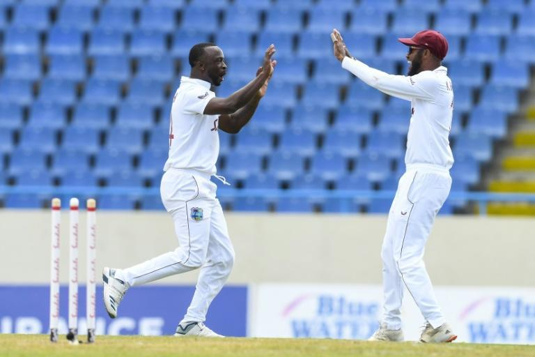 Kemar Roach (L) celebrates the first of his two wickets in the afternoon session against Sri Lanka