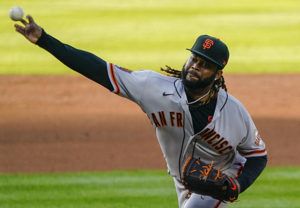 San Francisco Giants starting pitcher Johnny Cueto throws to the plate against the Colorado Rockies during the first inning of a baseball game, Monday Aug. 3, 2020, in Denver. AP Photo/Jack Dempsey)