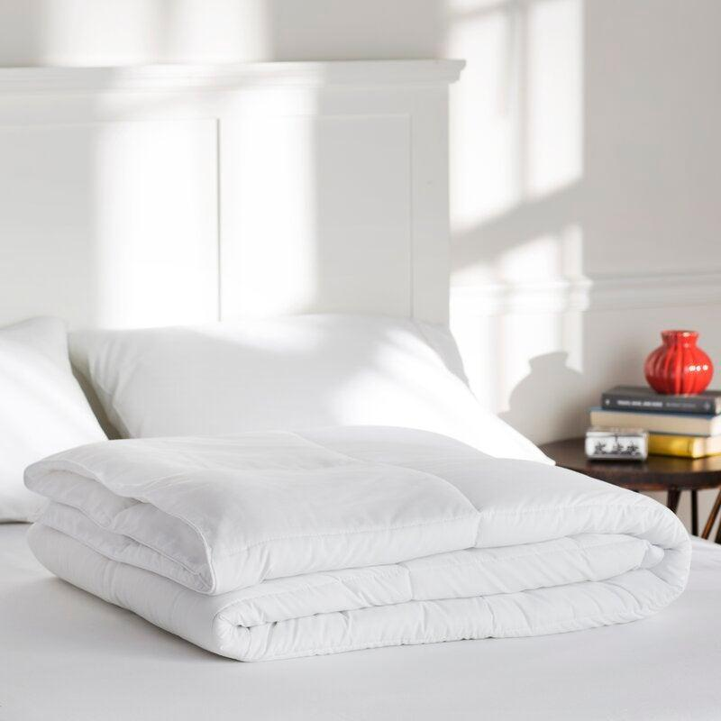 "<h2>The Twillery Co. All Season Down Alternative Comforter</h2><br>Stay cool during the summer and toasty during the winter months with The Twillery's alternative down comforter. Crafted from microfiber, this hypoallergenic style features a secure box stitch to prevent the fill from shifting as you hit snooze over and over. <br><br><strong>The Hype:</strong> 4.5 out of 5 stars and 12,018 reviews on <a href=""https://fave.co/2GzU5B2"" rel=""nofollow noopener"" target=""_blank"" data-ylk=""slk:Wayfair"" class=""link rapid-noclick-resp"">Wayfair</a><br><br><strong>Comfort Seekers Say:</strong> ""We live in FL and we like to keep our AC temps very cool at night in order to use comfy covers when we sleep at night, and this blanket is perfect. It's soft, fluffy, and lightweight. It also washes up nice and I have it on all for beds in the house I love them so much!"" –– <em>Cindy, Wayfair Reviewer </em><br><br><strong>The Twillery Co.u2122</strong> All Season Down Alternative Comforter, $, available at <a href=""https://go.skimresources.com/?id=30283X879131&url=https%3A%2F%2Fwww.wayfair.com%2Fbed-bath%2Fpdp%2Fthe-twillery-co-all-season-down-alternative-comforter-w000466475.html"" rel=""nofollow noopener"" target=""_blank"" data-ylk=""slk:Wayfair"" class=""link rapid-noclick-resp"">Wayfair</a>"