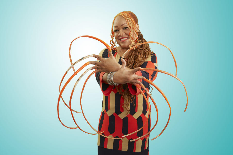 <p>Ayanna Williams has the longest fingernails in the world. They have a combined measurement of 576.4cm (18 ft 10.9 inches) and it takes around a week to paint them all. Williams looks after her nails by using anti-bacterial wash every day and a nail brush. (PA) </p>