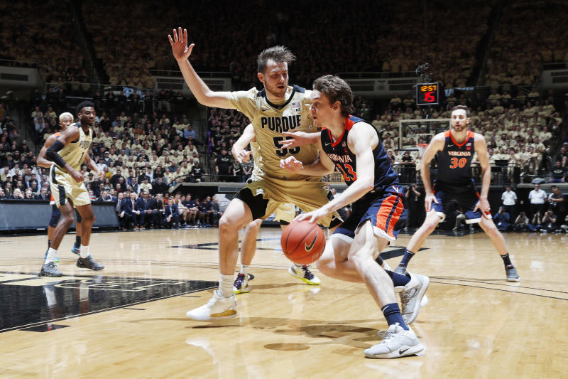 A Virginia roster that lost its top talent from last year's NCAA championship team struggled to score against Purdue. (Brian Spurlock/USA Today)