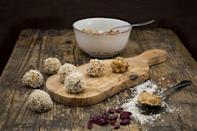 """<p>Peanuts supply satiating protein while naturally occurring melatonin in tart cherries may give them sleep-inducing powers. And sleep is widely recognized as playing a <a href=""""https://www.runnersworld.com/health-injuries/a28339532/how-much-sleep-do-i-need/"""" rel=""""nofollow noopener"""" target=""""_blank"""" data-ylk=""""slk:vital role in exercise performance"""" class=""""link rapid-noclick-resp"""">vital role in exercise performance</a>.</p><p><strong>Ingredients:<br></strong>1 cup pitted dates<br>1/2 cup unsalted roasted peanuts<br>1 cup dried cherries<br>3/4 cups quick cook oats<br>1/3 cup peanut butter<br>1/8 teaspoon salt (omit if using salted peanut butter)</p><p><strong>Directions: </strong>Place dates in a bowl, cover with hot water and let soak 30 minutes. Drain and pat excess water away with a paper towel. Place peanuts in a food processor bowl and process until pulverized into small pieces. Add dates, cherries, oats, peanut butter and salt. Blend until mixture sticks together when pressed between your fingers. Roll into 1-inch balls and keep chilled. You should get about 18 balls. <em>Makes 9 servings</em><br></p>"""