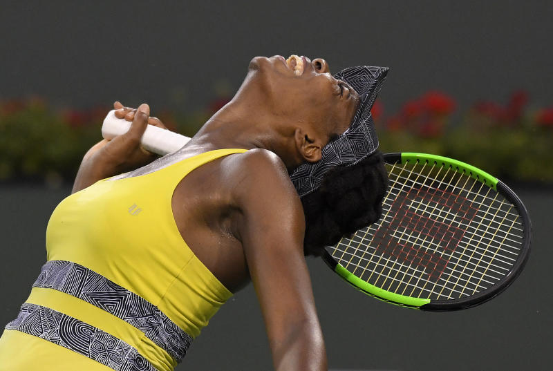 Venus Williams reacts after losing a point to Elena Vesnina, of Russia, at the BNP Paribas Open tennis tournament, Thursday, March 16, 2017, in Indian Wells, Calif. (AP Photo/Mark J. Terrill)