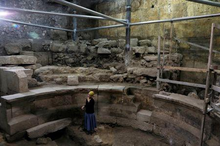 Israel Antiquities Authority archaeologist Tehillah Lieberman stands inside a theatre-like structure during a media tour to reveal the structure which was discovered during excavation works underneath Wilson's Arch in the Western Wall tunnels in Jerusalem's Old City October 16, 2017. REUTERS/Ronen Zvulun
