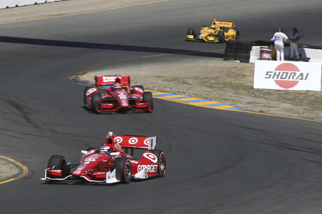 First place winner Scott Dixon, (9), takes a corner followed by Tony Kanaan, (10), and eventual second-place winner Ryan Hunter-Reay, (28), during the GoPro Grand Prix of Sonoma IndyCar series auto race, Sunday, Aug. 24, 2014, in Sonoma, Calif. (AP Photo/Elijah Nouvelage)
