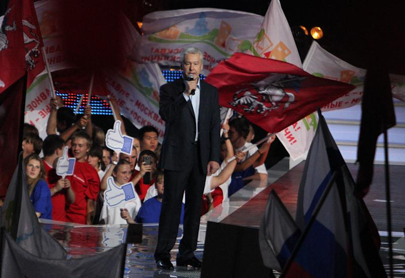 Moscow's incumbent mayor Sergei Sobyanin speaks to his supporters at a rally in Moscow, Friday, Sept. 6, 2013. Sobyanin, backed by President Vladimir Putin, will face Alexei Navalny, the anti-corruption blogger and a leader of the Russian protest movement in the upcoming Moscow's mayor election on Sept. 8. (AP Photo/Denis Tyrin)
