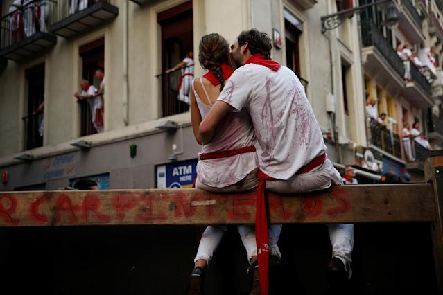<p>Revellers sit on the bull run barrier before the first running of the bulls at the San Fermin festival in Pamplona, northern Spain, July 7, 2017. (Susana Vera/Reuters) </p>