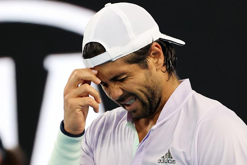 Fernando Verdasco reacts in pain as he plays against Germany's Alexander Zverev during their men's singles match on day six of the Australian Open.