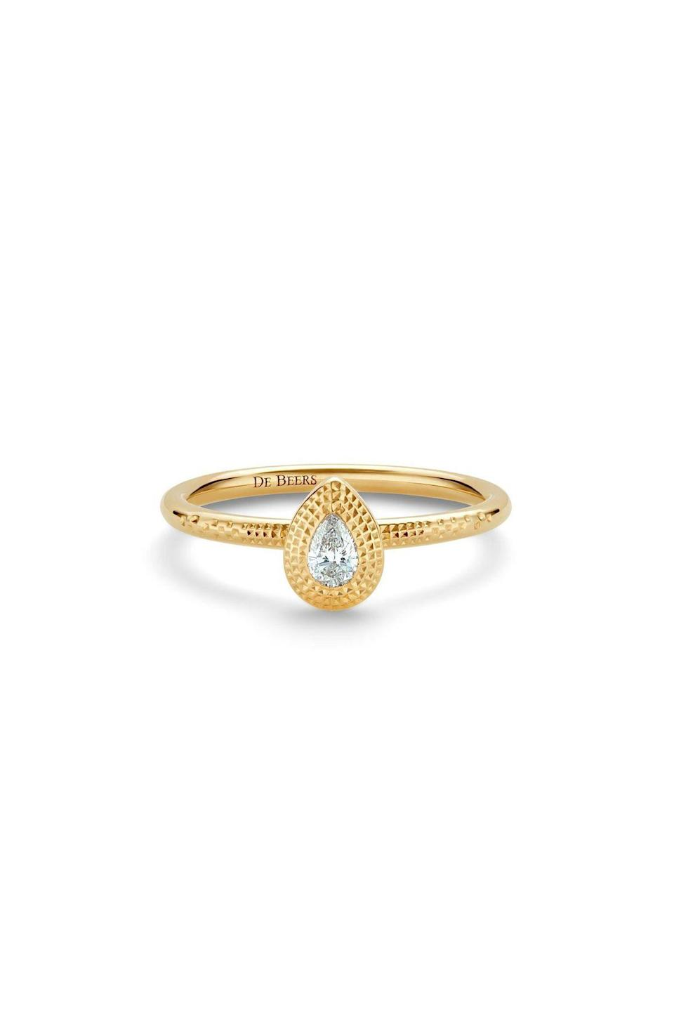 """<p><strong>De Beers</strong></p><p>debeers.com</p><p><strong>$1550.00</strong></p><p><a href=""""https://www.debeers.com/en-us/talisman-pear-shaped-diamond-ring-in-yellow-gold/R102391.html"""" rel=""""nofollow noopener"""" target=""""_blank"""" data-ylk=""""slk:Shop Now"""" class=""""link rapid-noclick-resp"""">Shop Now</a></p><p>A hand-hammered finish and a rough diamonds make this solitaire stand out from the rest. </p>"""