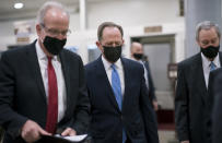 Sen. Jerry Moran, R-Kan., left, Sen. Pat Toomey, R-Pa., and others head to the chamber as the Senate holds a voting marathon on the Democrats' $1.9 trillion COVID-19 relief bill that's expected to end with the chamber's approval of the measure, at the Capitol in Washington, Friday, March 5, 2021. (AP Photo/J. Scott Applewhite)