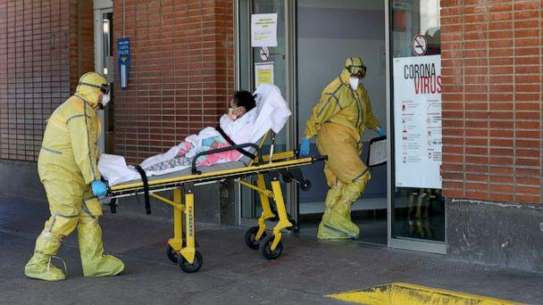 PHOTO: Ambulance workers in full protective gear arrive with a patient at the Severo Ochoa Hospital during the coronavirus outbreak in Leganes, Spain, March 26, 2020.  (Susana Vera/Reuters)
