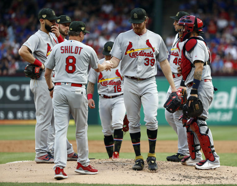 St. Louis Cardinals manager Mike Shildt (8) takes the ball from starting pitcher Miles Mikolas (39) in the second inning of a baseball game against the Texas Rangers in Arlington, Texas, Friday, May 17, 2019. (AP Photo/Tony Gutierrez)