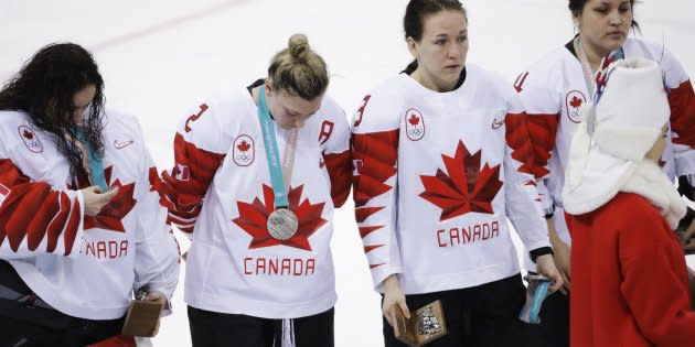 Canada's Jocelyne Larocque, second from right, holds her silver medal after losing to the U.S in the women's gold medal hockey game at the Winter Olympics in Gangneung, South Korea on Feb. 22, 2018.