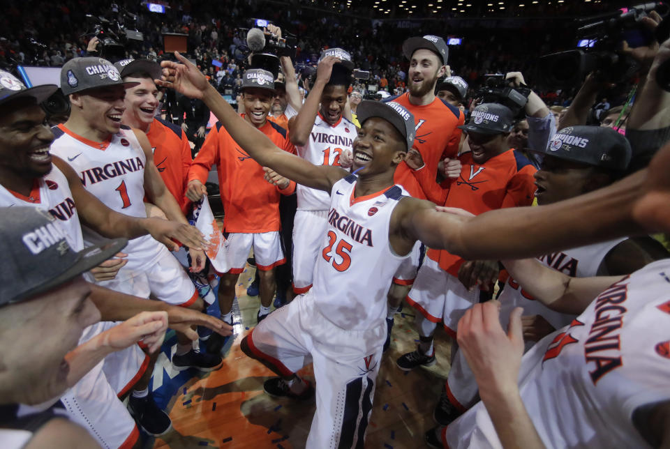 Virginia won its third conference title Saturday night, and looks to be the top team in the NCAA tournament. (AP Photo/Julie Jacobson)
