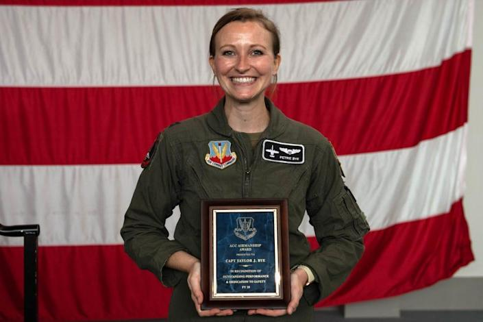 Capt. Taylor Bye, 75th Fighter Squadron pilot and chief of standardization and evaluation, poses for a photo after receiving the Air Combat Command Airmanship Award at Moody Air Force Base, Georgia, May 5, 2021.