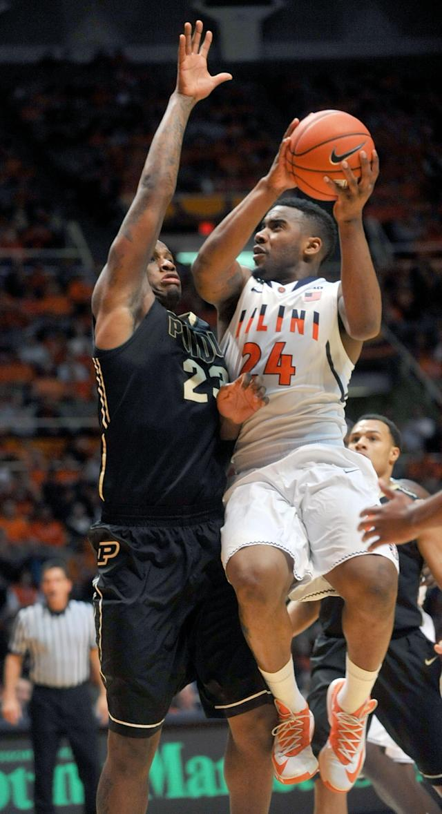 Illinois guard Rayvonte Rice (24) goes up with a shot against Purdue forward Jay Simpson (23) during the first half of an NCAA college basketball game Wednesday, Jan. 15, 2014, in Champaign, Ill. (AP Photo/Rick Danzl)
