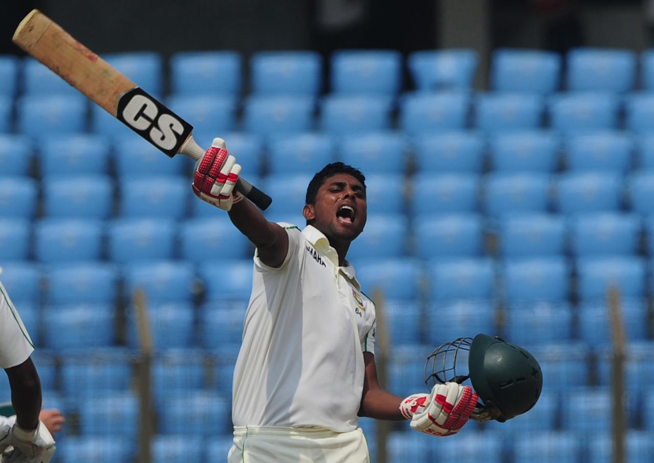 Bangladesh batsman Sohag Gagi celebrates after scoring a century (100 runs) during the fourth day of the first cricket Test match between Bangladesh and New Zealand at The Zahur Ahmed Chowdhury Stadium in Chittagong on October 12, 2013. AFP PHOTO/Munir uz ZAMAN        (Photo credit should read MUNIR UZ ZAMAN/AFP/Getty Images)