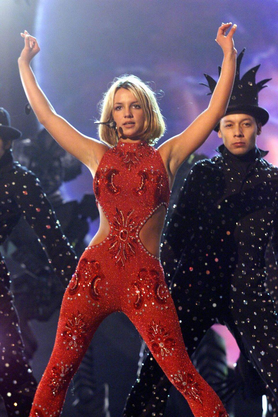 """<p>Britney """"It's Britney, b*tch!"""" Spears shimmered onstage in a sparkly red jumpsuit during her performance. </p>"""