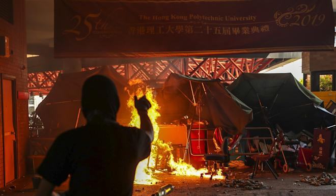 Protesters on Monday set fires and vandalise facilities at Polytechnic University in Hung Hom. Photo: Sam Tsang