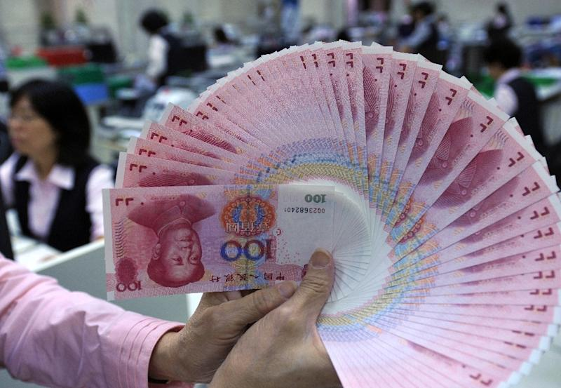 After decades of closely controlling its currency, the renminbi or yuan, China is now moving to internationalize it, and asking that it be included in the IMF's benchmark basket of major currencies (AFP Photo/Patrick Lin)