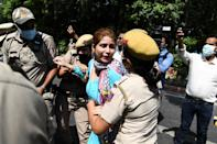 Police detain a Congress Party activist during an anti-government demonstration to protest against the recent passing of new farm bills in parliament in New Delhi on September 28, 2020. (Photo by Sajjad HUSSAIN / AFP) (Photo by SAJJAD HUSSAIN/AFP via Getty Images)