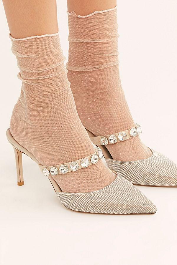 "<p>Steal the show this holiday season thanks to these glamorous <a href=""https://www.popsugar.com/buy/Jeffrey-Campbell-Private-Event-Mules-515133?p_name=Jeffrey%20Campbell%20Private%20Event%20Mules&retailer=freepeople.com&pid=515133&price=148&evar1=fab%3Aus&evar9=46878925&evar98=https%3A%2F%2Fwww.popsugar.com%2Ffashion%2Fphoto-gallery%2F46878925%2Fimage%2F46878998%2FJeffrey-Campbell-Private-Event-Mules&list1=shopping%2Choliday%2Cwinter%2Ceditors%20pick%2Cwinter%20fashion%2Choliday%20fashion&prop13=mobile&pdata=1"" rel=""nofollow"" data-shoppable-link=""1"" target=""_blank"" class=""ga-track"" data-ga-category=""Related"" data-ga-label=""https://www.freepeople.com/shop/private-event-mule/?category=shoes&amp;color=013"" data-ga-action=""In-Line Links"">Jeffrey Campbell Private Event Mules</a> ($148). </p>"