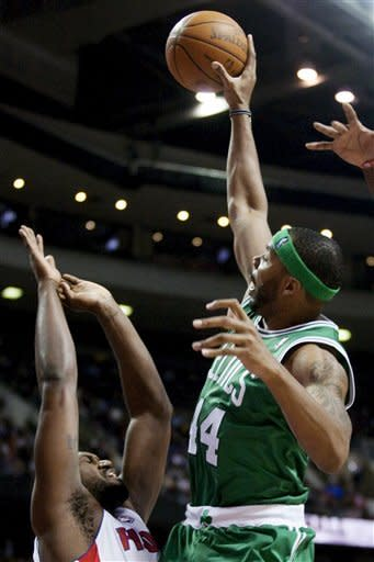 Boston Celtics' Chris Wilcox (44) shoots against Detroit Pistons' Jason Maxiell in the first half of an NBA basketball game, Sunday, Feb. 19, 2012, in Auburn Hills, Mich. (AP Photo/Duane Burleson)
