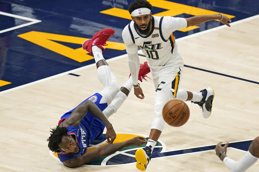 Los Angeles Clippers guard Patrick Beverley, left, and Utah Jazz guard Mike Conley (10) vie for a loose ball during the second half of an NBA basketball game Friday, Jan. 1, 2021, in Salt Lake City. (AP Photo/Rick Bowmer)