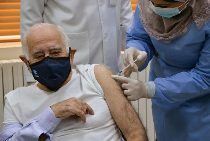 Jordanian Doctor Dawoud Hananiah, receives the first COVID-19 vaccine in Jordan, at a medical center in Amman