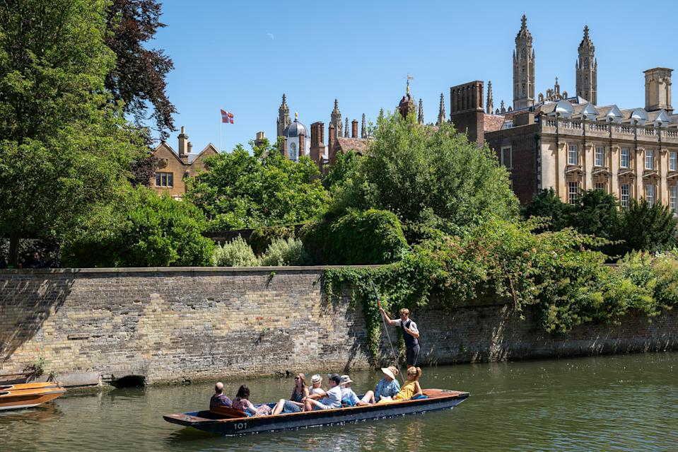 People enjoy the hot weather as they take punt tours along the River Cam in Cambridge. (PA Wire)