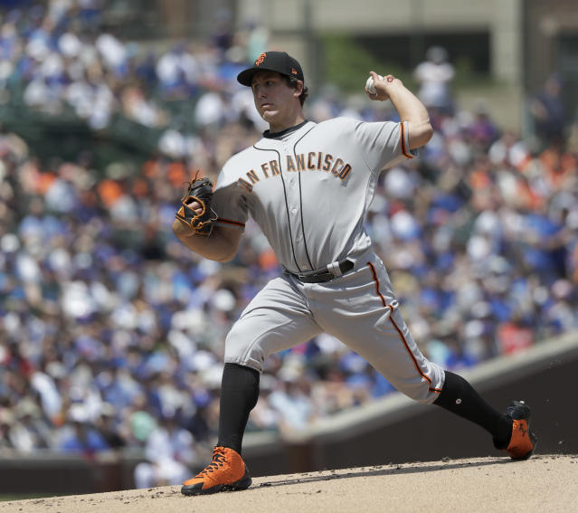 San Francisco Giants starting pitcher Derek Holland delivers during the first inning of a baseball game against the Chicago Cubs Friday, May 25, 2018, in Chicago. (AP Photo/Charles Rex Arbogast)