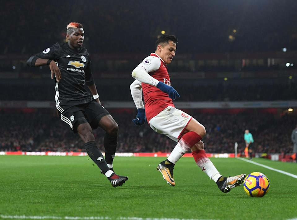 Alexis Sanchez (right) during a 2017 game against Manchester United. (Getty)