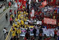 University students and members of Indonesian labour organisations take part in a protest over human rights, corruption and social and environmental issues in Jakarta, Indonesia