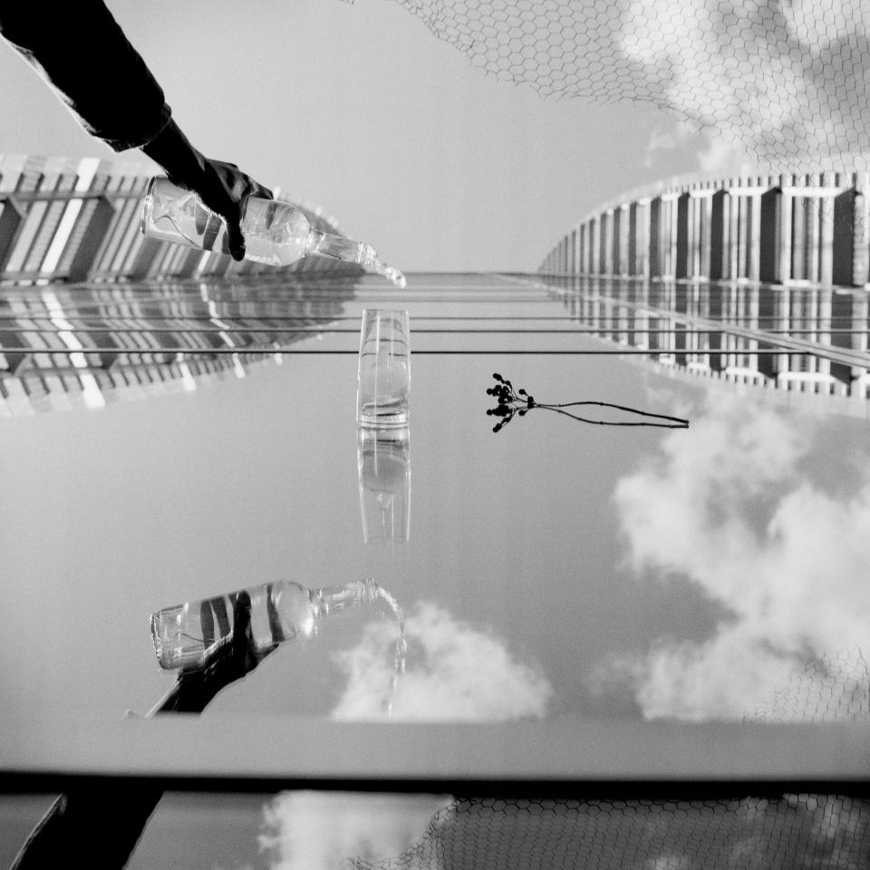 """'Lie Down' is a surrealist collection of pictures that create the feeling of being upright on a vertical surface. The objects on each image talk to the viewer and tell them about a distort reality from a subjective point of view by playing with installations under natural light and reflections. Each urban skyscape represents a different scenario, from a observation to contemporary issues to a close look into the artist's experiences. The pictures from the Lie Down collection are analog shots composed on the camera and consist of a highly manipulated reality rather than combination printing or digital airbrushing. (Edurne Aguinaga, Spain, Finalist, Conceptual, Professional Competition, 2013 Sony World Photography Awards) <br> <br> <a href=""""http://worldphoto.org/about-the-sony-world-photography-awards/"""" rel=""""nofollow noopener"""" target=""""_blank"""" data-ylk=""""slk:Click here to see the full shortlist at World Photography Organisation"""" class=""""link rapid-noclick-resp"""">Click here to see the full shortlist at World Photography Organisation</a>"""