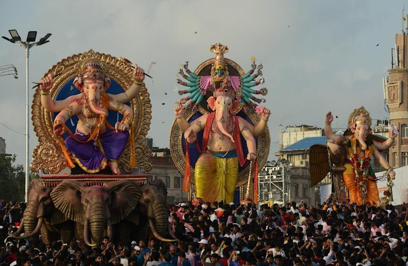 Indian devotees carry statues of Hindu god Lord Ganesha for immersion in the Arabian sea in Mumbai on September 5, 2017