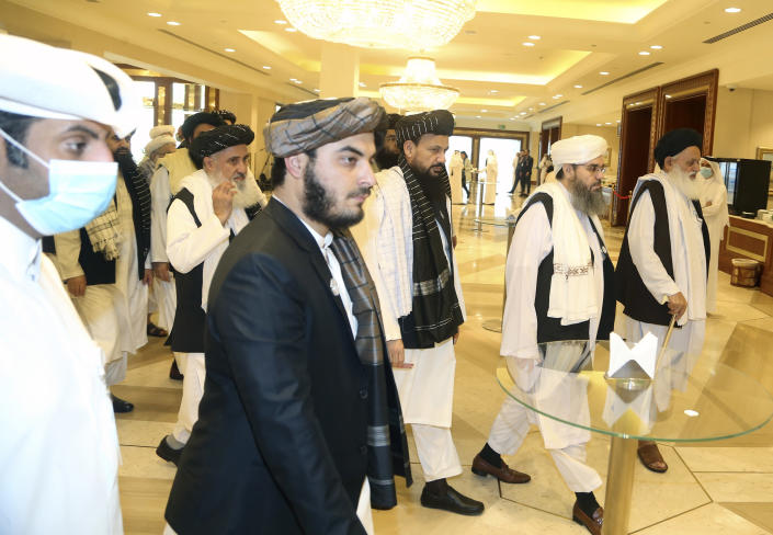 Taliban delegation arrive to attend the opening session of the peace talks between the Afghan government and the Taliban in Doha, Qatar, Saturday, Sept. 12, 2020. (AP Photo/Hussein Sayed)