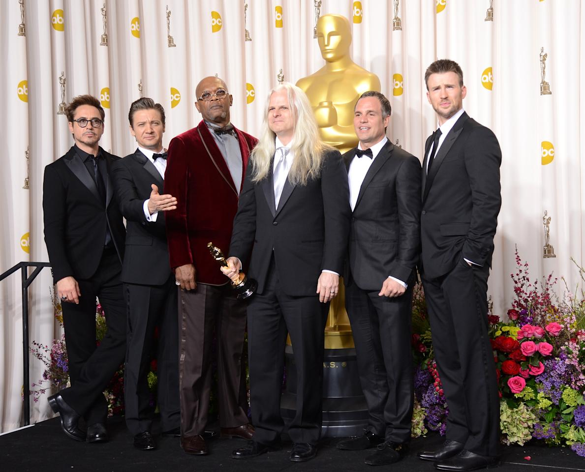 "HOLLYWOOD, CA - FEBRUARY 24:  Cinematographer Claudio Miranda (C), winner of the Best Cinematography award for ""Life of Pi,"" with presenters (L-R) Robert Downey Jr., Jeremy Renner,  Samuel L. Jackson, Mark Ruffalo and Chris Evans, pose in the press room during the Oscars held at Loews Hollywood Hotel on February 24, 2013 in Hollywood, California.  (Photo by Jason Merritt/Getty Images)"