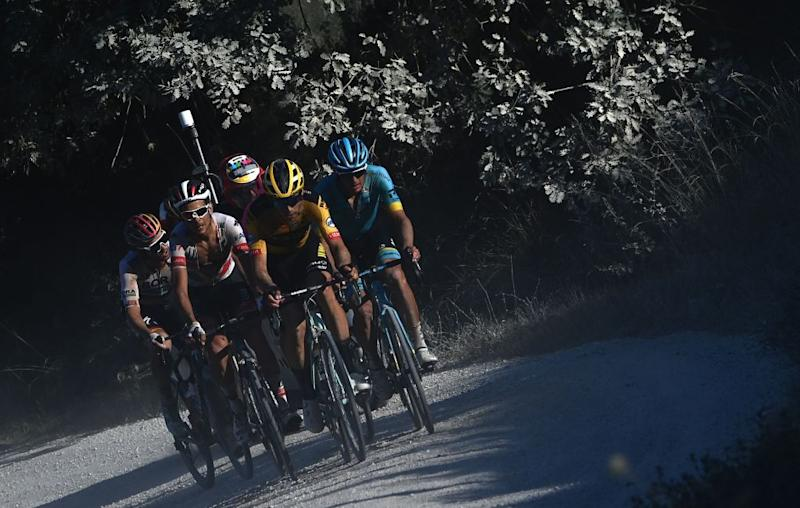 Team JumboVisma Belgian rider Wout van Aert C leads the break away through a dusty gravel road in the oneday classic cycling race Strade Bianche White Roads on August 1 2020 around Siena Tuscany Photo by Marco BERTORELLO AFP Photo by MARCO BERTORELLOAFP via Getty Images