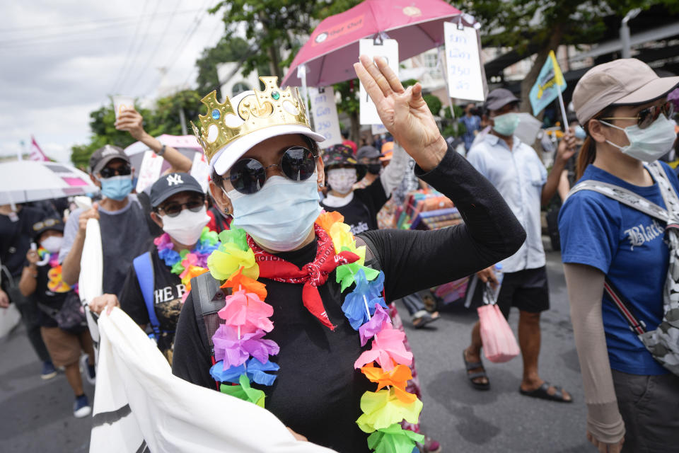 A pro-democracy supporter shows the three-finger salute of defiance during a demonstration in Bangkok, Thailand, Thursday, June 24, 2021. Anti-government protests expected to resume in Bangkok after a long break due partly to a surge in COVID-19 cases. Gatherings are planned for several locations across the capital, despite health officials mulling a week-long lockdown in Bangkok to control a rampant virus surge. (AP Photo/Sakchai Lalit)