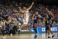 <p>LSU guard Tremont Waters (3) reacts after rebounding the ball while being defended by Yale guard Alex Copeland (3) during the second half of the first round men's college basketball game in the NCAA Tournament, in Jacksonville, Fla. Thursday, March 21, 2019. (AP Photo/Stephen B. Morton) </p>