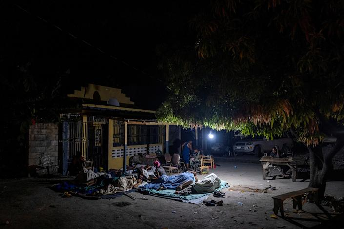 """People rest outside their home after tremors shook buildings in Les Cayes on Aug. 19.<span class=""""copyright"""">Ricardo Arduengo—Reuters</span>"""