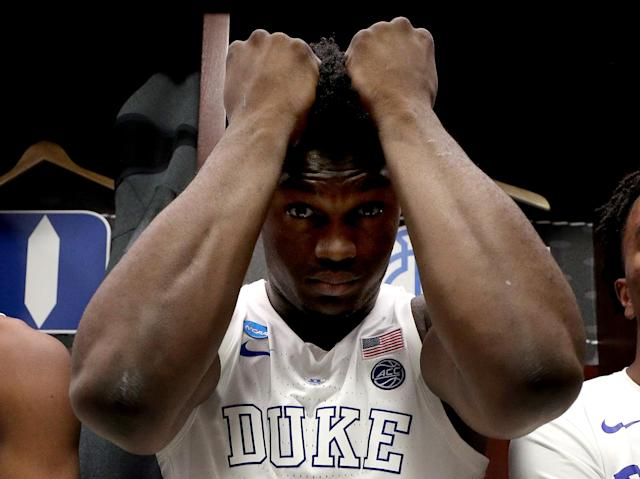 "<a class=""link rapid-noclick-resp"" href=""/nba/players/6163/"" data-ylk=""slk:Zion Williamson"">Zion Williamson</a> of the <a class=""link rapid-noclick-resp"" href=""/ncaaw/teams/duke/"" data-ylk=""slk:Duke Blue Devils"">Duke Blue Devils</a> reacts after his team's 68-67 loss to the <a class=""link rapid-noclick-resp"" href=""/ncaaf/teams/michigan-st/"" data-ylk=""slk:Michigan State Spartans"">Michigan State Spartans</a> in the 2019 NCAA basketball tournament. (Getty)"