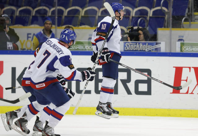 Slovakia's Martin Reway (R), Jakub Predajniansky (C) and David Griger celebrate after scoring a goal against the U.S. during the second period of their IIHF World Junior Championship ice hockey game in Malmo, Sweden, December 28, 2013. REUTERS/Alexander Demianchuk (SWEDEN - Tags: SPORT ICE HOCKEY)